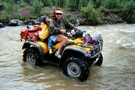 Palin and Piper (the child without a helmet) Riding at ATV Across a Stream